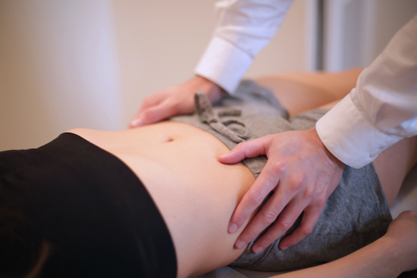 Osteopath manipulating a patient